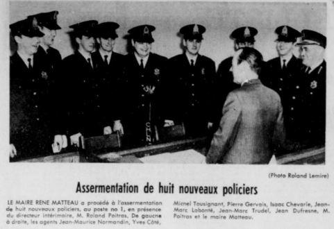Dans Le Nouvelliste du 9 décembre 1969, on aperçoit Jean-Maurice Normandin (à gauche) lors de l'embauche de plusieurs policiers appelés à travailler au poste no. 1. De dos, on reconnaît le maire René Matteau, ainsi que Roland Poitras à l'extrême droite.